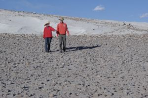 Visitors in a field of volcanic bombs